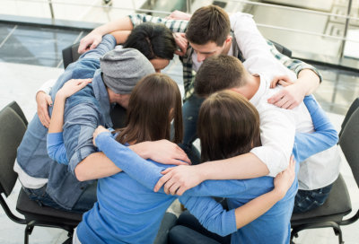 Group of people close together in circle