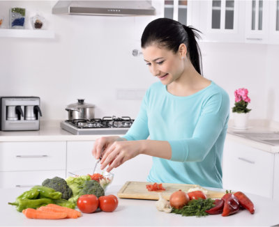 Woman is is chopping spices
