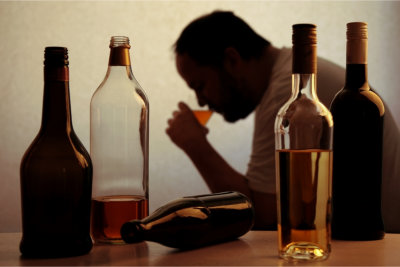 Man suffering from alcohol addiction