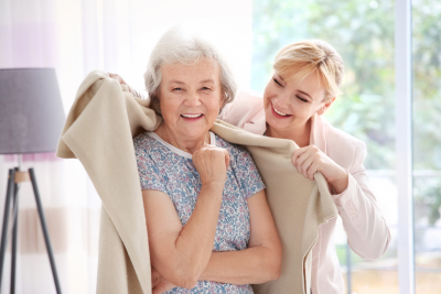 Caregiver covering senior woman